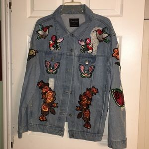 Jean Jacket Distressed with Patches. Size XL
